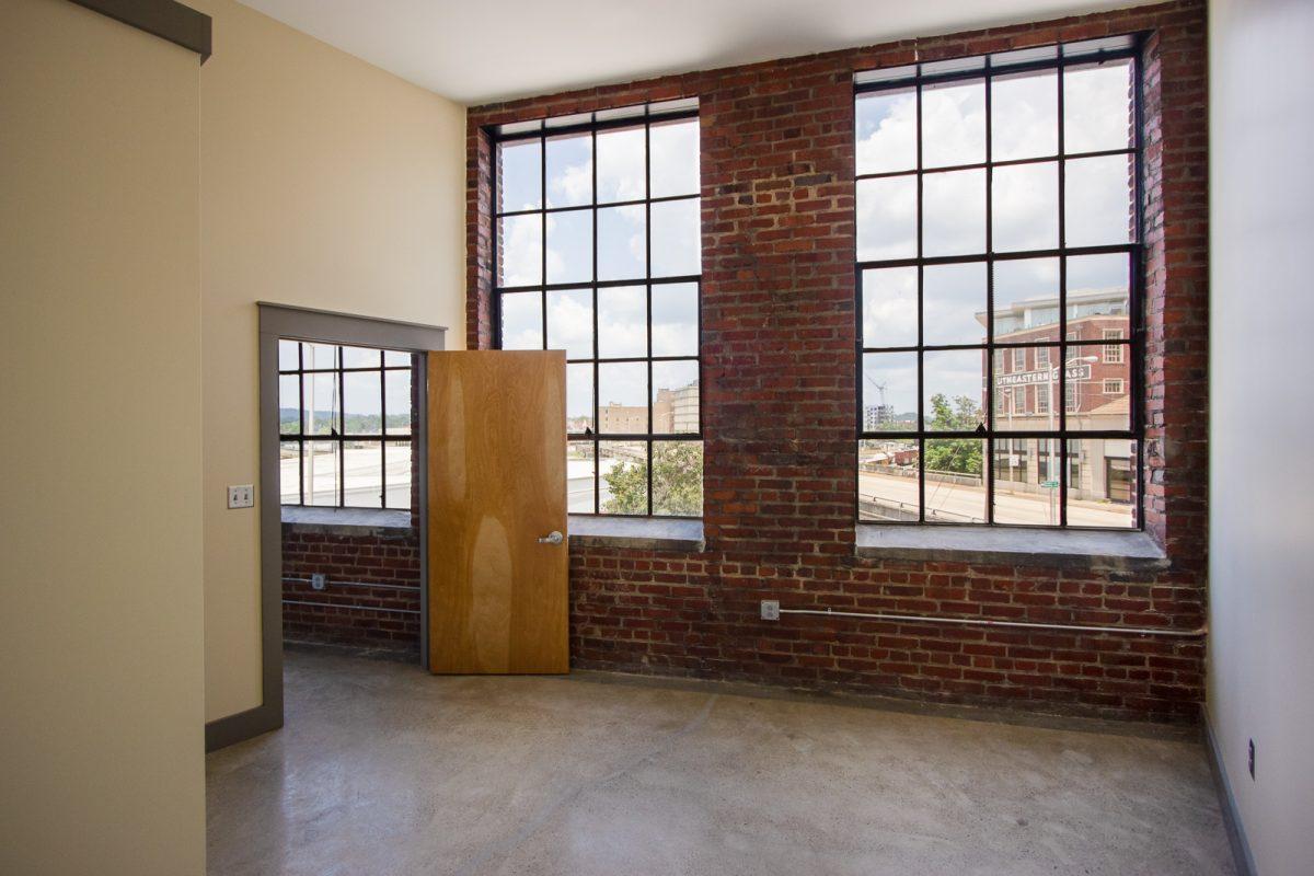Large windows at Keener Building apartment bedroom